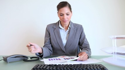 Businesswoman working on charts
