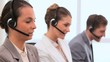 Call centre agents talking with headsets