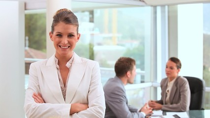 Smiling businesswoman standing upright