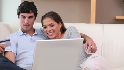 Couple using a credit card
