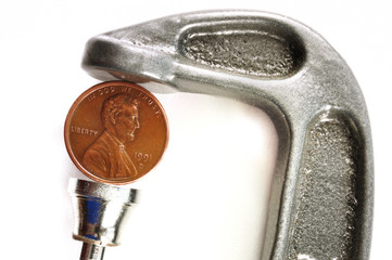 Pinching a Penny in a C Clamp