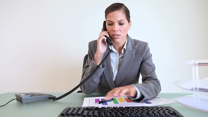 Serious businesswoman talking on the phone