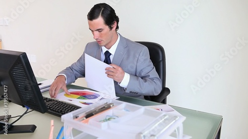 Businessman working on graphs