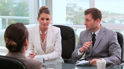 Businesswoman talking with managers