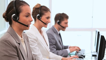 Call centre agents working with computers