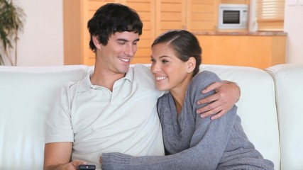 Relaxed couple watching the television