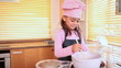 Smiling girl cooking