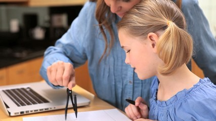 Mother and daughter drawing with a compass