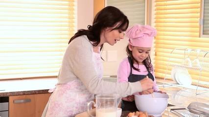 Young girl stirring something