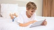Smiling boy using a tablet pc
