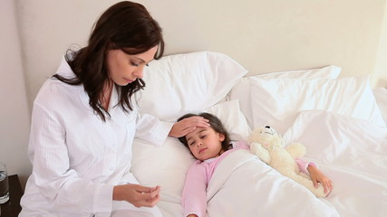 Sick little girl lying in a bed