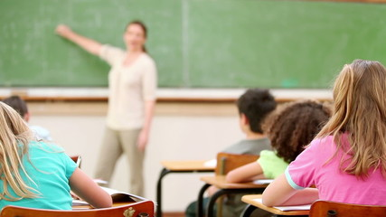 Teacher talking to the children