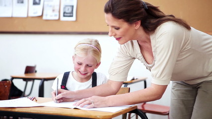 Smiling teacher talking to a pupil