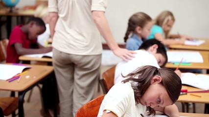 Teacher watching her pupils