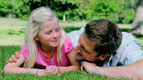 Father and daughter smiling as they look at each other