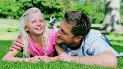 Father talking to his smiling daughter before looking