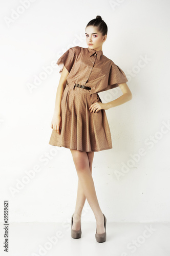 Attractive young fashion woman standing on podium