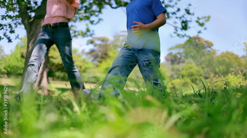 Low angle shot of a family skipping alongside each