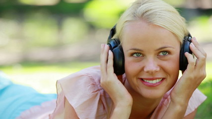 Close up of a woman listening to music and moving her head