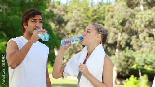 A couple take a break from training as they drink water