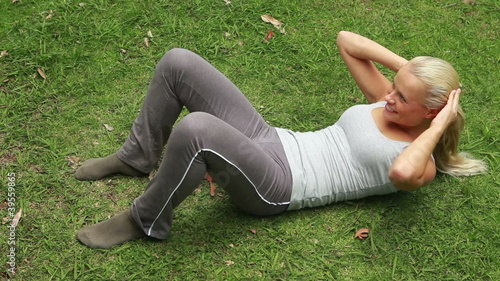 A woman working out in the park