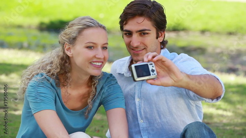 A couple pose for a picture together as they check it out and laugh