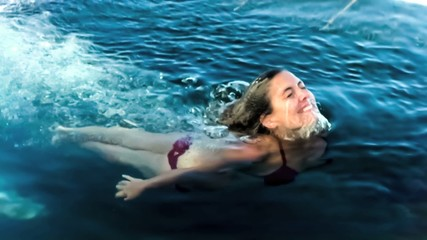 Woman emerging for water in slow motion