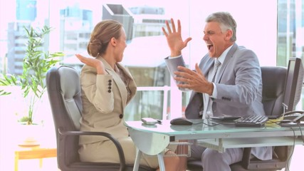 Business people in slow motion giving high-five