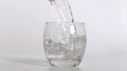 Water being poured heavily in slow motion