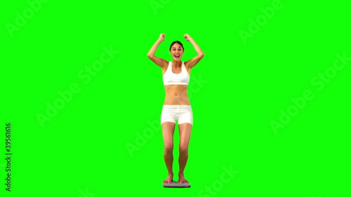 Woman on a weighing scale in slow motion