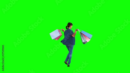 Teenage girl in slow motion holding shopping bags