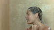 Young brunette in slow motion showering