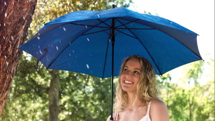 Woman holding an umbrella in slow motion
