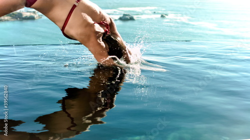 Woman diving into the water in slow motion