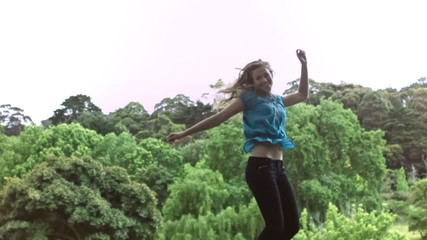 Happy woman jumping in slow motion