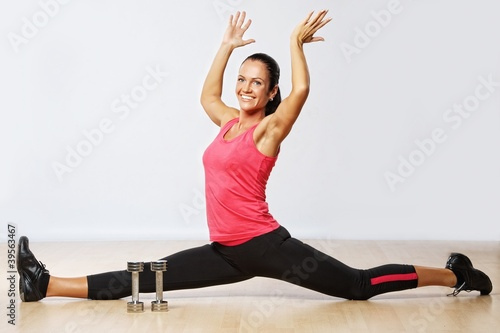 Beautiful woman exercising in fitness club.