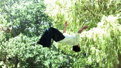 Man performing a back-flip in slow motion