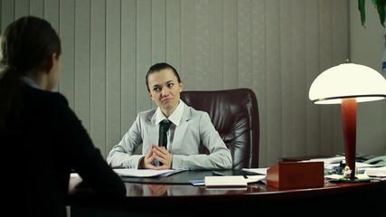 Boss communicate bad news to female worker, steadicam shot