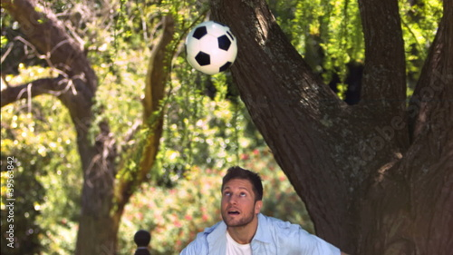 Man in slow motion playing soccer