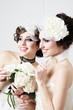 Two sisters brides having fun