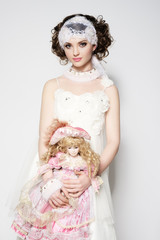 Beautiful young bride with baby doll
