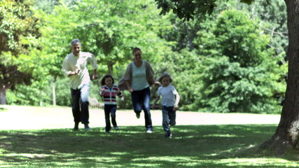 Family running in slow motion together