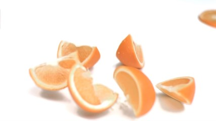 Orange falling into pieces in super slow motion