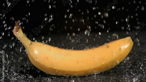 Water raining on banana in super slow motion