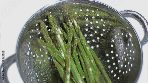 Asparagus in sieve in super slow motion