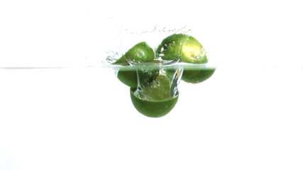 Lemons falling into water in super slow motion