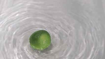 Lime turning in water in super slow motion