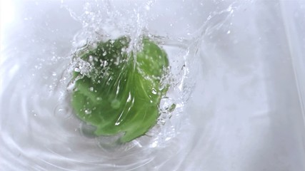 Pepper falling into water in super slow motion