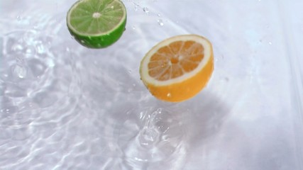 Fruits falling into water in super slow motion