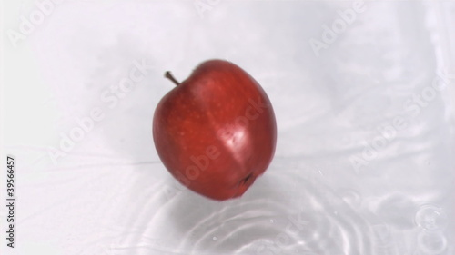 Apple falling into water in super slow motion